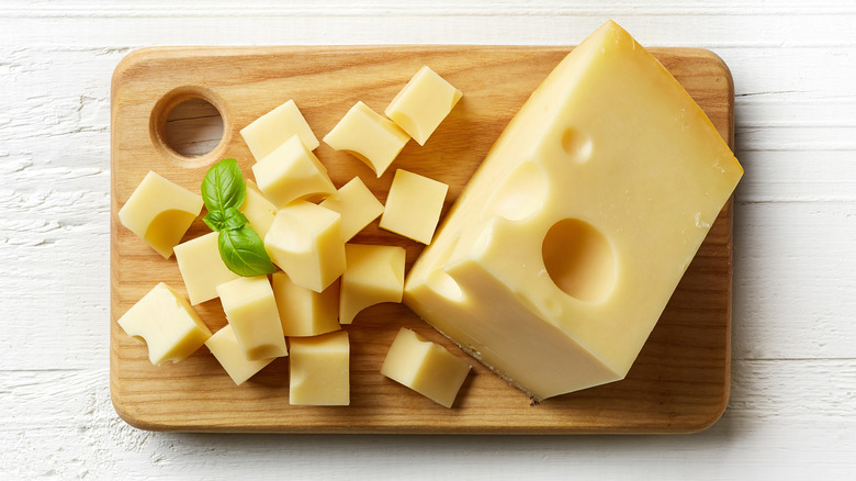 Swiss cheese on a board