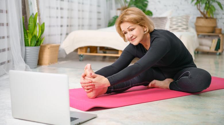 woman doing  side forward fold