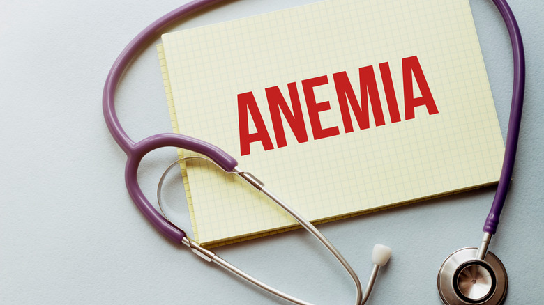 stethoscope and the word anemia written on a pad of paper