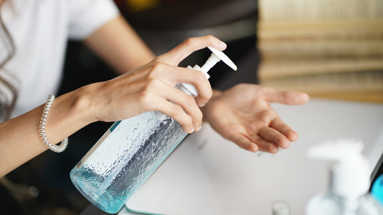 Woman washing her hands with antibacterial soap
