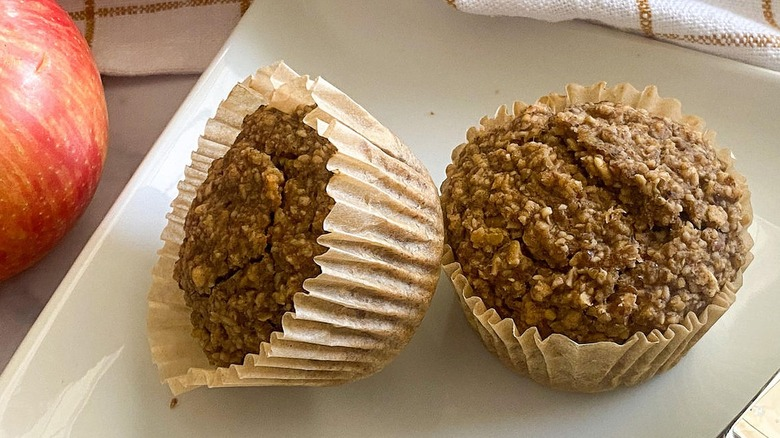 Two muffins sitting on a plate