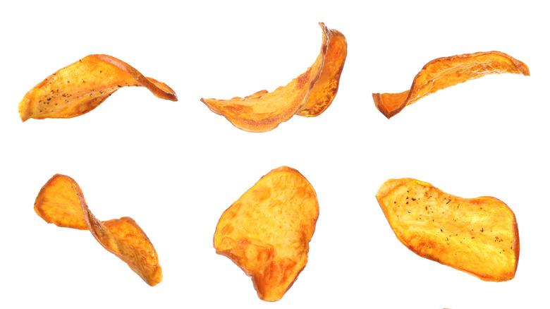 seasoned baked potato chips on an isolated white background