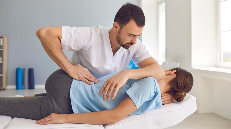 chiropractor working on female patient