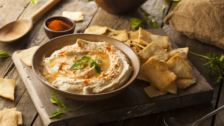 pita chips with a bowl of hummus