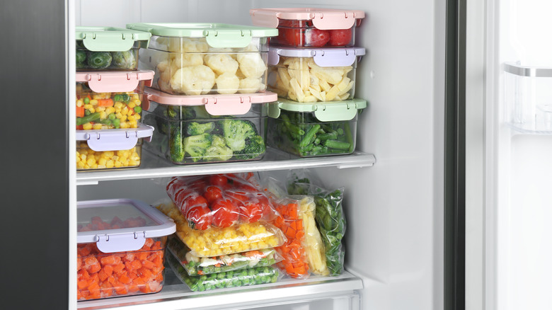 Food containers stacked in refrigerator