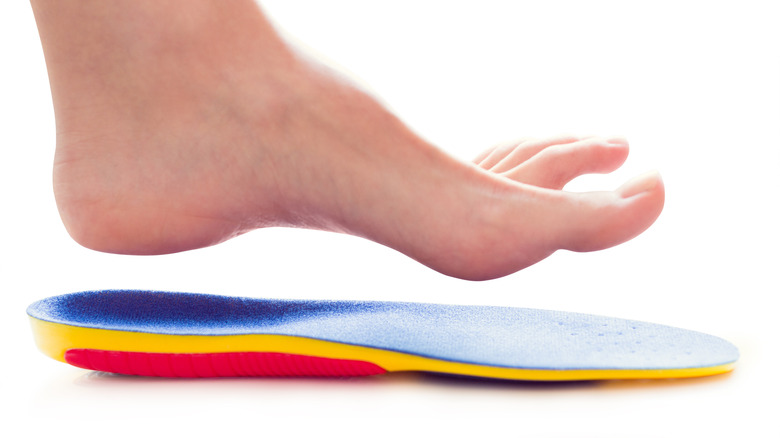 foot suspended above insole