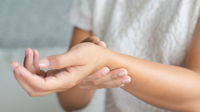 closeup of person holding painful wrist