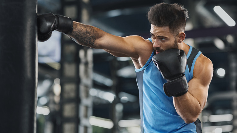 A man boxing in a gym