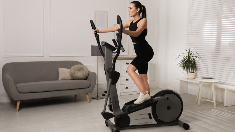 Fit woman using an elliptical trainer
