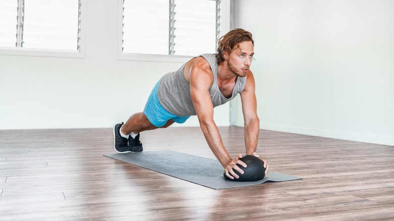 Man on exercise mat