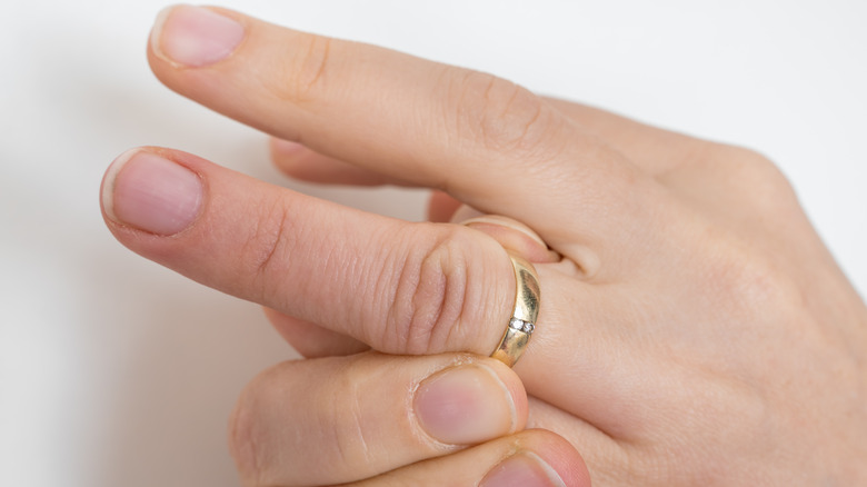 Person can't get ring off finger