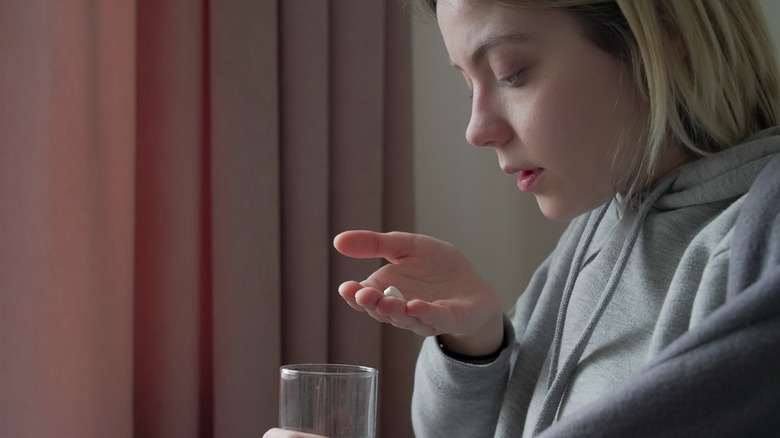 Girl holding a pill
