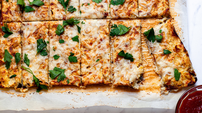 Colorful cauliflower cheesy breadsticks with parsley
