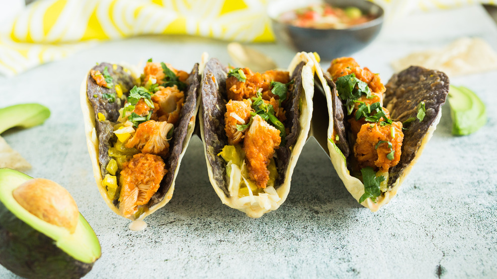 Tacos and burritos on a plate.