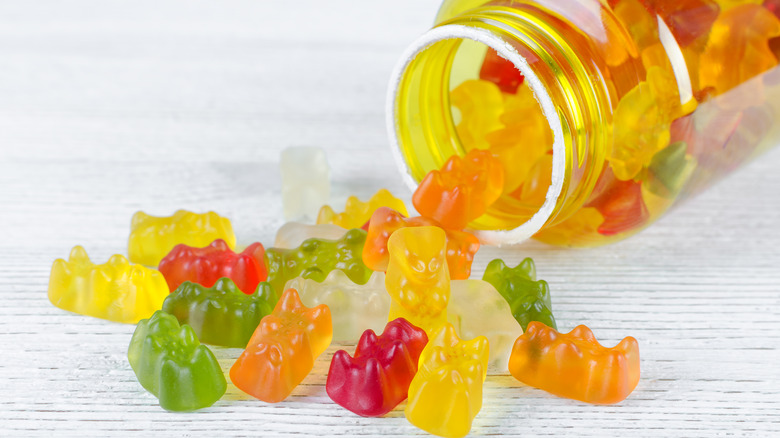 gummy vitamins spilling out of a jar