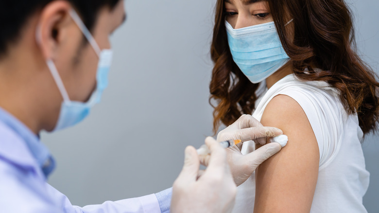 Woman getting vaccination