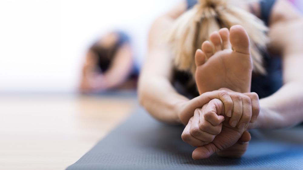 woman exercising barefoot