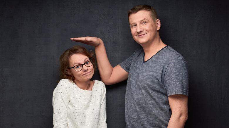 Taller man standing with short woman