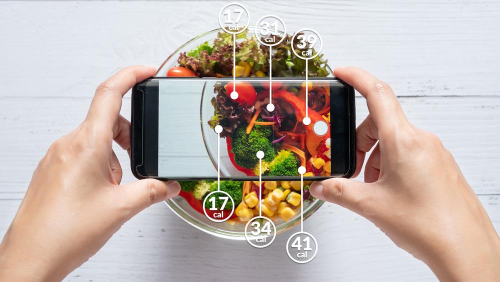 smartphone taking photo of food