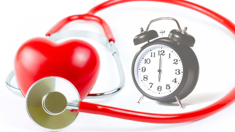 Heart with stethoscope and alarm clock