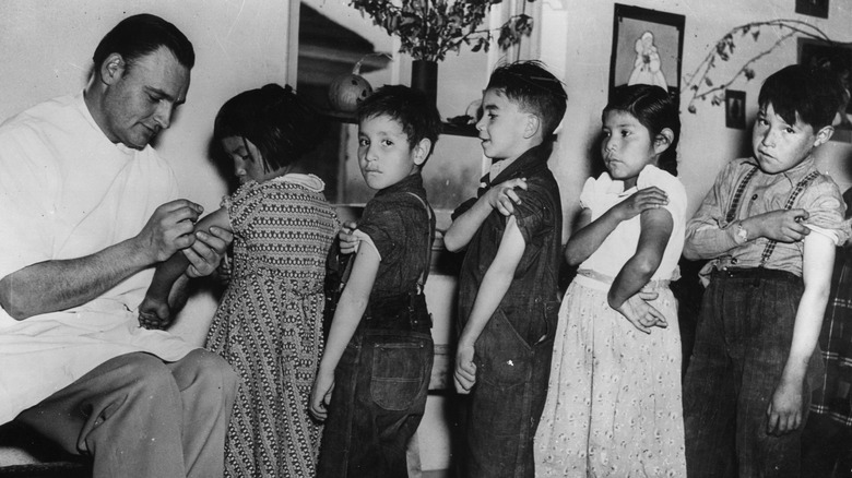 Kids lining up for vaccinations - historical