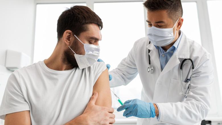 A man gets a COVID vaccine