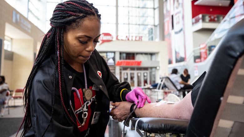 Woman drawing blood