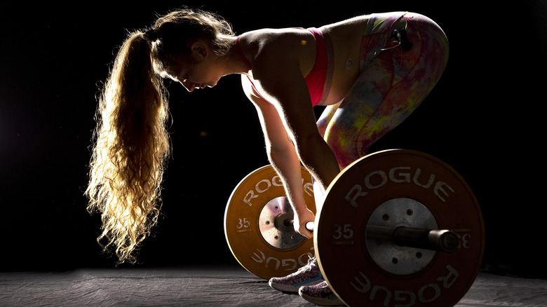 girl with rogue barbell