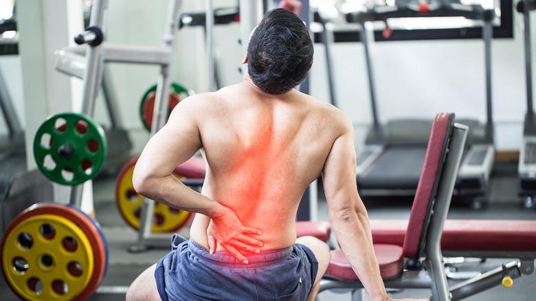 man exercising at gym back pain
