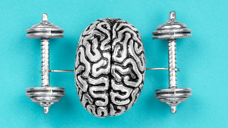 brain in between dumbbells