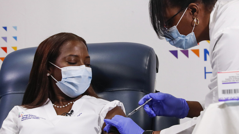 A nurse receives the Pfizer coronavirus vaccine at Long Island Jewish Medical Center in Queens, New York, in January