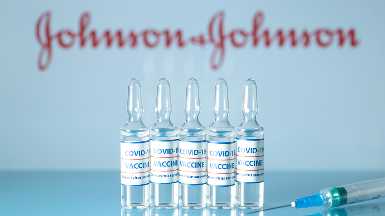COVID-19 vaccine vials with Johnson and Johnson sign
