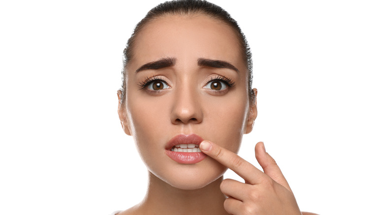 woman concerned about cold sore on her lip