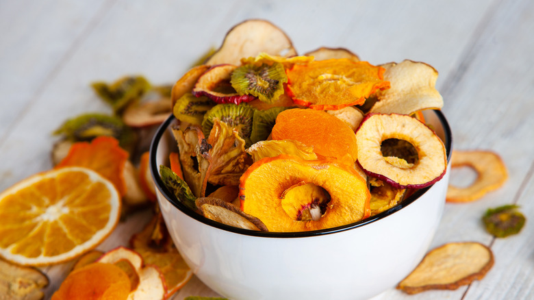 bowl containing an assortment of dried fruit