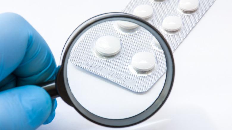 pills under a microscope