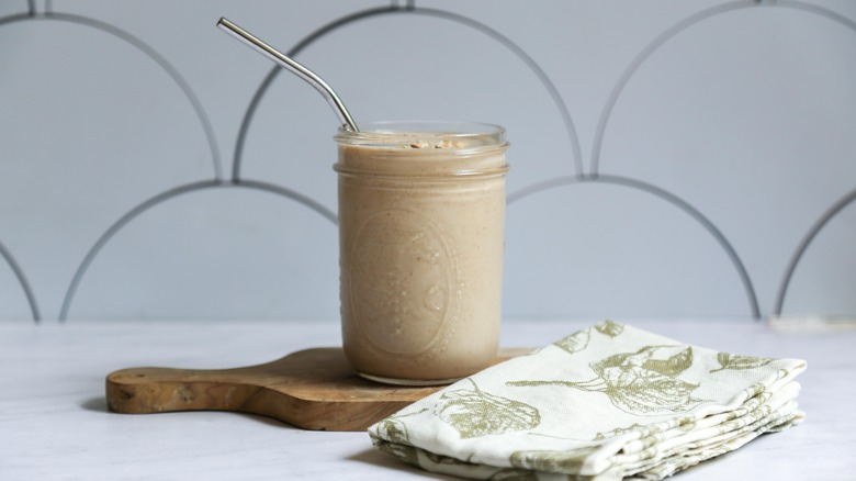 oatmeal smoothie with a metal straw in it