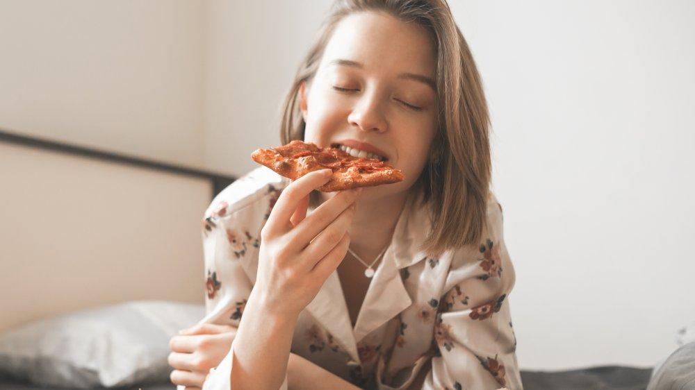 enjoying pizza