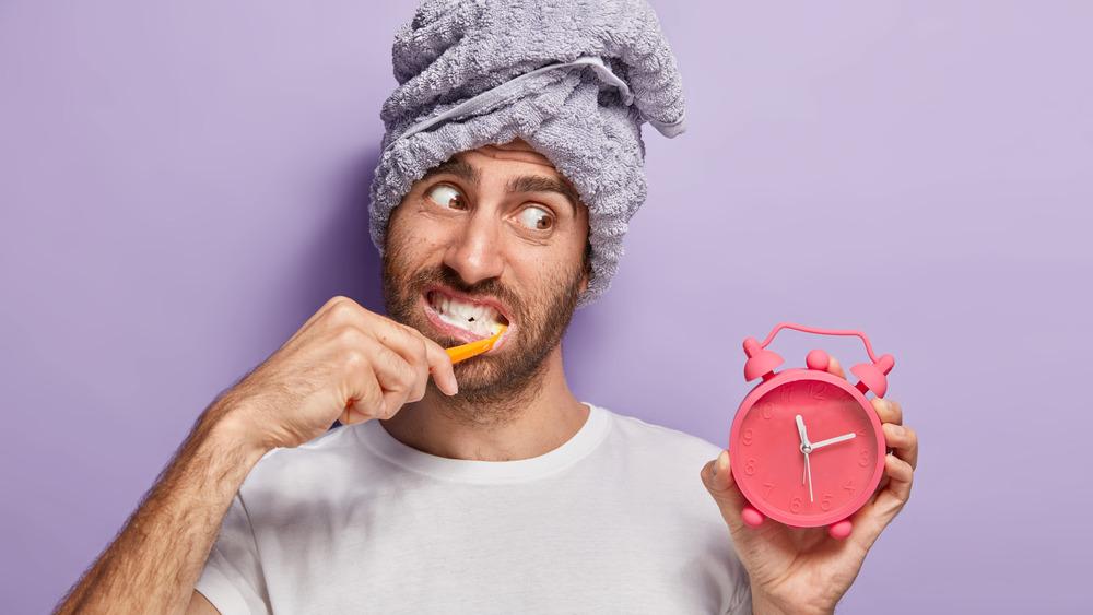 Man brushing teeth with timer
