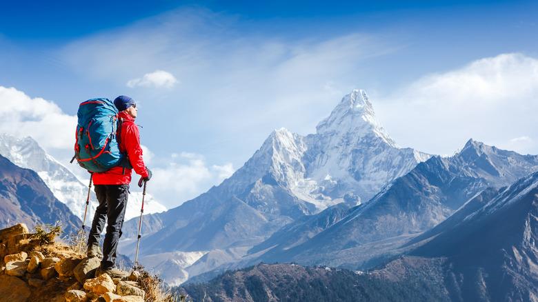 A man summits a large mountain
