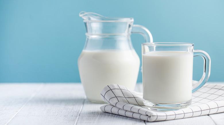 A pitcher and mug of milk