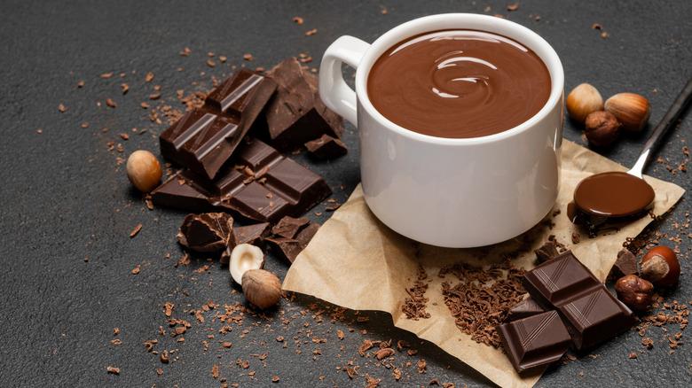 Dark chocolate with mug of hot chocolate