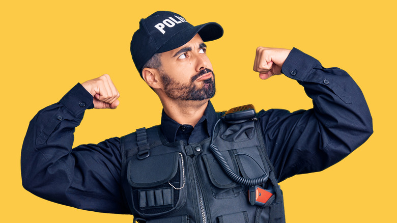 policeman flexing muscles