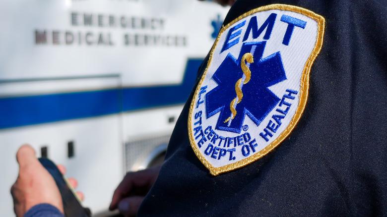 Close-up of a person's EMT shoulder badge