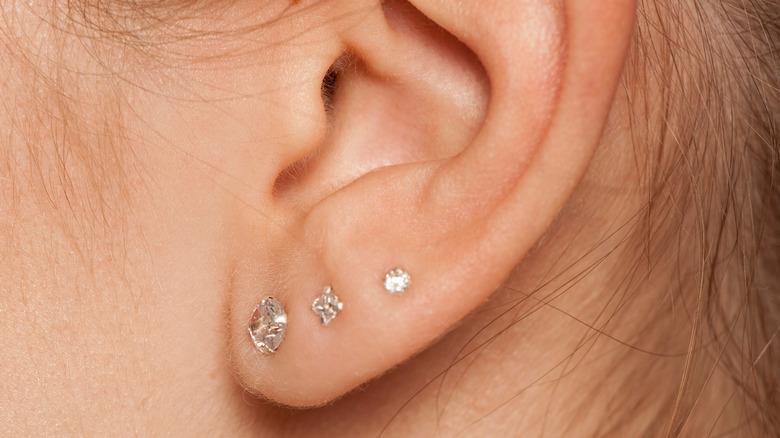 Woman's ear lobe piercing