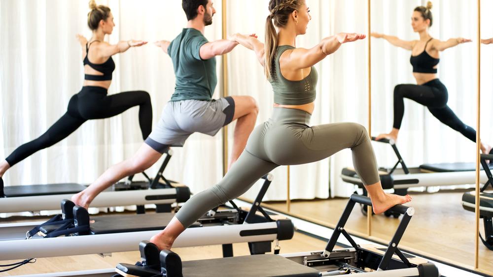 Pilates class using reformer