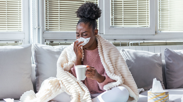 A woman has a cold at home