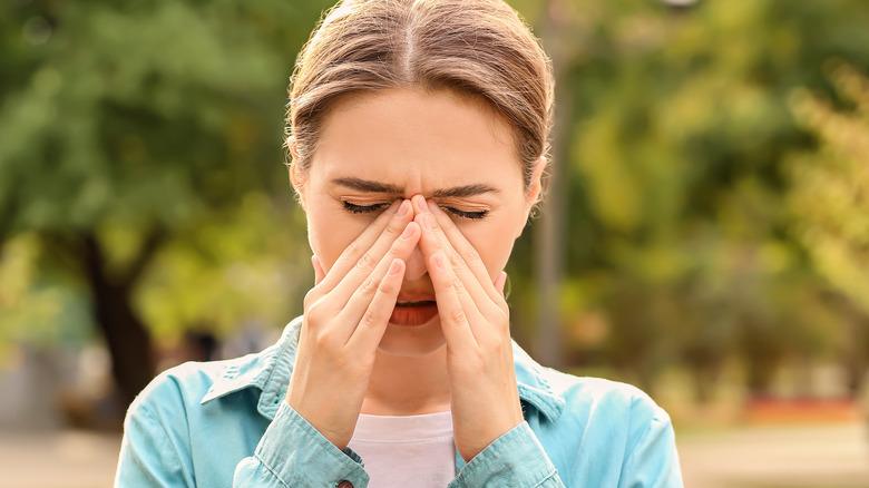 A woman experiencing seasonal allergies