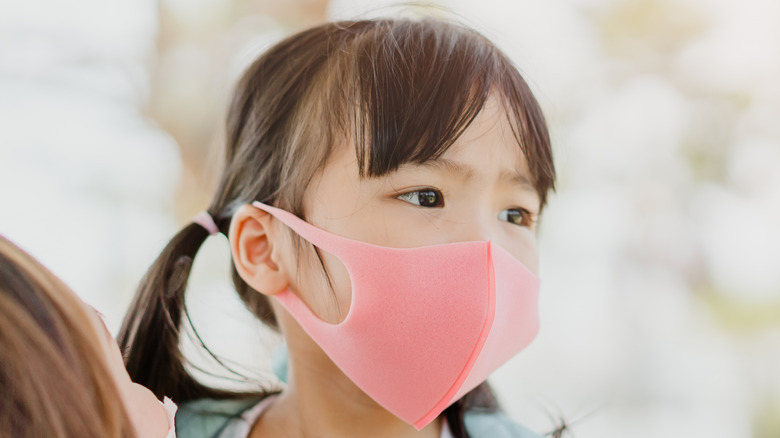 Child wearing a face mask
