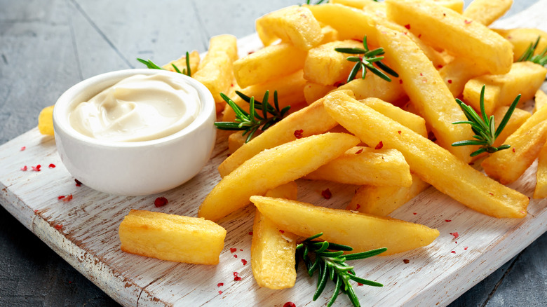 mayonnaise on a plate of french fries