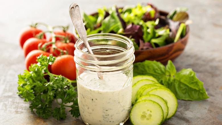 Ranch dressing in a mason jar with fresh vegetables